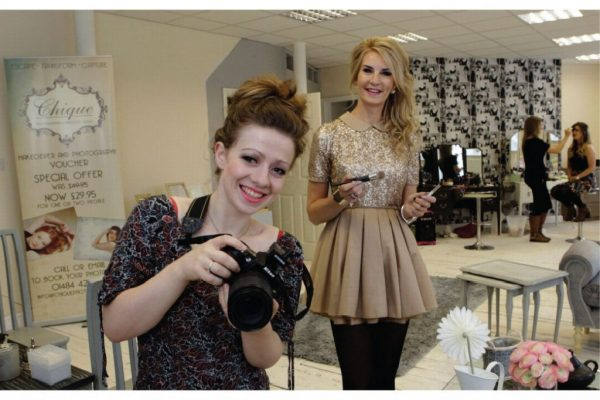 business owners with camera and makeup equipment in Chique photography studio Huddersfield