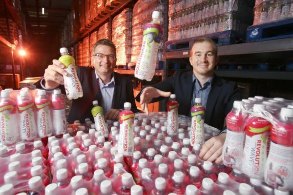 Pallets of Revolution Waves soft drinks in York with owner Charlie Simpson Daniel and Andy Clough of BEF