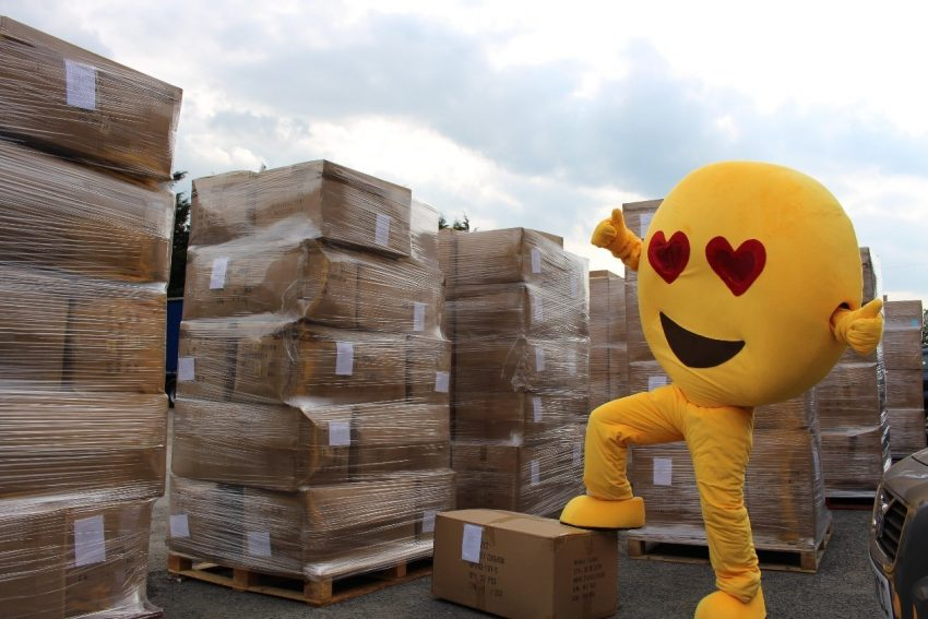 Love Bomb Cusions mascot with shipping containers
